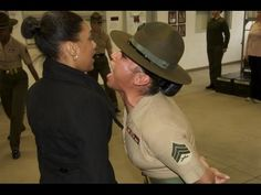 Female Marine Drill Instructor drilling Marine Wives