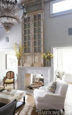 Rustic elegance... love the old door on the mantel