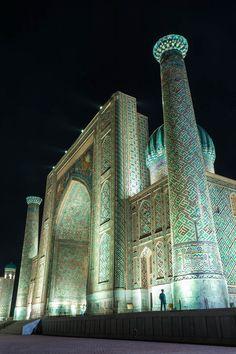 The Registan in Samarkand, Uzbekistan lit up at night.