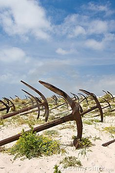 Cemetery of the old anchors. Barril beach, Island of Tavira, Portugal.