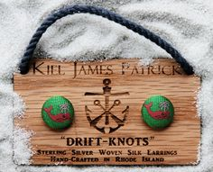 """Love these """"drift-knots"""" earrings--pink whales on a green background; by Kiel James Patrick, """"donnickberry spout"""" $22"""