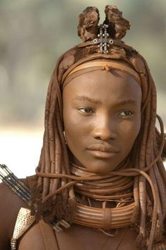 reminder that africa keeps its shit on lock. this is a Namibian Himba woman wearing traditional red clay cosmetics + hair dressings.
