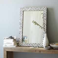 Reflect your style. Our popular Parsons Wall Mirror gets a sophisticated new look, now available in a solid wood and bone inlay frame painted with a cool grey herringbone pattern. It reinterprets the original iconic Parsons design with a simple yet substantial frame that brings dimension and texture to a room.