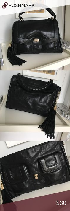 """Cynthia Rowley Leather Purse w/ Tassel Black leather Cynthia Rowley purse. Great tassel on the side. It can switch sides. Two outer pockets, two pockets and a zippered pocket inside.                          12""""L x 9"""" T x 5"""" base.  Handle 6"""" T.                              Good condition. A couple of small ink marks on the inside & some of the silver has rubbed off on the front clasp (see pics). Cynthia Rowley Bags Satchels"""