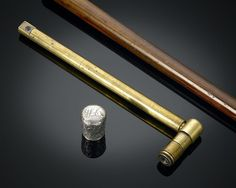 Periscope Walking Stick - Surreptitiously catch a closer look with this rare British periscope cane. The embossed silver knob unscrews to reveal the brass periscope inside, allowing the user to peer out over objects without the fear of detection.<br><br>Periscope marked R