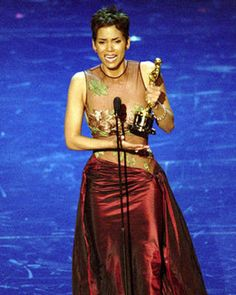 In 2002, Halle Berry accepted the Best Actress Oscar in a dramatic Elie Saab dress with a peekaboo top and striking satin skirt.