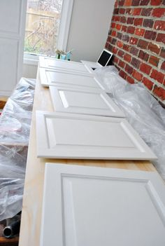 Young House Love: great tips on how to paint the perfect finish on cabinets (can be used for other furniture as well). Furniture Projects, Furniture Makeover, Home Projects, Diy Furniture, Antique Furniture, Modern Furniture, Young House Love, Painting Cabinets, Painting Woodwork