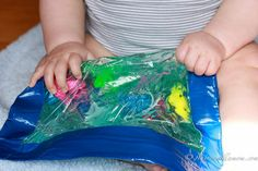 Baby sensory bag - Freezer ziplock bag, some hair gel, duct tape, and small items to put in the bag.