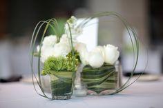 cool flower arrangement. wrap large leaf around inside clear vase