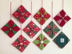 Fabric Ideas - Kevin MacLeod made a great video showing how to make origami folded fabric ornaments. Thanks to his video I've been having a blast making Christmas ornaments! Fabric Christmas Decorations, Sewn Christmas Ornaments, Origami Christmas Ornament, Folded Fabric Ornaments, Origami Ornaments, Noel Christmas, Handmade Christmas, Quilted Ornaments, Christmas Music