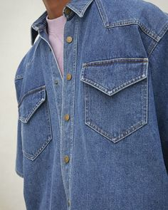 Super cool denim shirt with short-sleeves, influenced by wild western style. With soft details in the pockets, button, and collar, wear this with a pair of jeans for a true Canadian tuxedo look. Wear the sleeves rolled-up or straight down. Oversized Denim Shirt, Canadian Tuxedo, Western Style, Button Up Shirts, Fall Winter, Women Wear, Short Sleeves, Pockets, Jeans