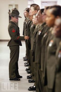 Marine drill instructor inspects her female recruits during boot camp training, with its combination of strict discipline and exhaustive physical training, is considered the most rigorous of the armed forces recruit training.