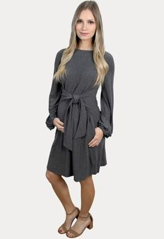 Bishop Sleeve Pregnancy Dress with Tie Front - Sexy Mama Maternity Fun, flirty and flattering! Our bishop sleeve pregnancy dress has it all. Features a stylish tie front, high neck and puff sleeves. This dress is a wardrobe must have! A perfect layering basic or can be worn solo. Designed for wear throughout all nine months of pregnancy and beyond! Pregnancy Dress, Pregnancy Months, Maternity Gowns, Maternity Fashion, Fall Maternity, Stylish Dresses, Dresses For Work, Bishop Sleeve, Puff Sleeves