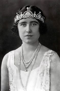 | THE LOTUS FLOWER TIARA | This was seen on the Queen Mother in her early years as Duchess of York and was subsequently retired from her regular tiara rotation. It was made from one of her wedding gifts, a necklace of a Greek key pattern with pendant diamonds and pearls given by her husband,H.M. King George VI of Great Britain  (1895-1952). Garrard dismantled it and created this tiara instead | H.M. Queen Elizabeth of Great Britain (1900-2002) wearing THE LOTUS FLOWER TIARA |