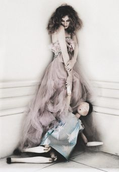 Its playtime! An almost haunting image of Karen Elson (accompanied by a giant doll) in Solder, Soldier, Wont You Marry Me? shot by the otherworldly Tim Walker for Vogue UK April 2008 What better way to feel loved than in a frenzy of tulle and feathered fondant-pink fancy? Karen wears an Elie Saab Couture S/S 2008 satin and tulle bustier dress with ostrick feathers and sequins.