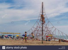 Download this stock image: Sports tourists play on the beach, Spain - H9G7M0 from Alamy's library of millions of high resolution stock photos, illustrations and vectors.