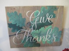 Beautiful one-of-a-kind hand lettered and hand painted sign on wood. Sign reads Give Thanks in cream lettering with a brown background and light and dark leaves on a branch. Dimensions are 10in x 8in x 1/4in Easy to hang with wire-backing already installed. Each sign is hand lettered, hand painted, and unique. This exquisite sign is perfect for decorating your home or gifting to someone else. Note: Because each sign is painted free-hand by the artist, there is only one of its kind. There ...