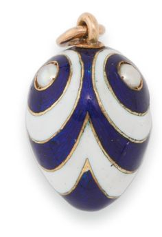 A Fabergé gem-set gold and guilloché enamel Easter egg pendant, workmaster August Hollming, St. Petersburg, 1898-1908, mounted with three seed pearls, each surrounded by rings of alternating cobalt blue over a guilloché ground and opaque white enamel emanating from the pearls.