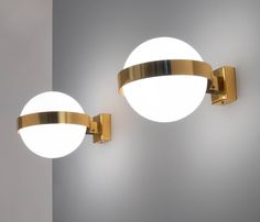 Extra Large Wall Lights in Brass with 'Floating' Globes | From a unique collection of antique and modern wall lights and sconces at https://www.1stdibs.com/furniture/lighting/sconces-wall-lights/