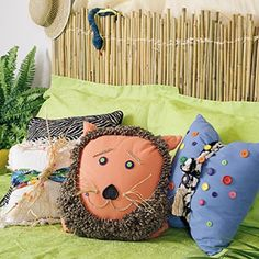 Transform boring purchased pillows to create a safari motif that any kid would love with just a few buttons, some raffia, beads, and braided fringe.