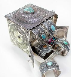 Sunshine Reeves. Turquoise and silver cuff bracelets inside a silver stamped box