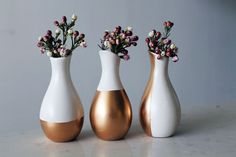 You know what your home needs? Gold! Whether you're decorating for a wedding, sprucing things up for a dinner party, or just feel like channeling your inner King Midas, these gold-dipped vases are a simple way to go for… the gold! :)