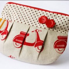 Pouch with red mopeds and buttons. So cute! I would prefer bicycles though:)