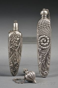 Three Small Sterling Scent Vials | Sale Number 2542B, Lot Number 866 | Skinner Auctioneers