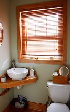 Interesting layout for a small bathroom, with a big window on a small wall, might be worth looking into.