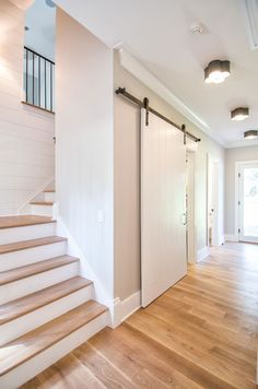 Modern Farmhouse Interior Influences Shiplap, sliding barn doors, bleached hardwood floors and rubbed oil bronze lighting | Cole Harris Associates LLC
