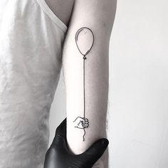 Hand poke balloon tattoo by Jake Haynes.