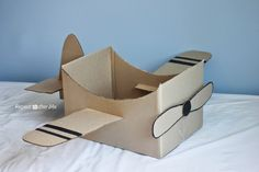 Repeat Crafter Me: Cardboard Box Airplane.. I remember playing airplane all the time as a kid with our couches