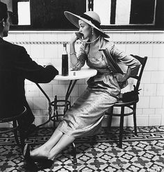 vintagegal:Jean Patchett photgraphed for Vogue by Irving Penn in a Café in Lima, Peru, 1948 (via)