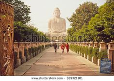 BODHGAYA, INDIA - JANUARY 8: Monks and other people rushing to 24.38 metre Buddha statue on January 8. 2013. Bodhgaya is a place of pilgrimage. Siddhartha Gautama attained enlightenment here at 500 BC