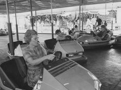 Rides aren't just for kids.  This visitor enjoys her ride on the bumper cars during the 1972 Indiana State Fair.