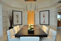 Contemporary Dining Room with specialty door, Pendant light, Brno Tubular Chair in White, Concrete floors, Mason Dining Table