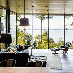 Glass-encased living room on Puget Sound
