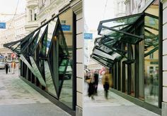 Fabios Restaurant in Vienna by BEHF Architekten makes the facade almost completely disappear via a clever vertical folding of the glass storefront.