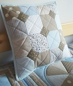 Love the colors and love the pattern. The quilting is really cool, too.