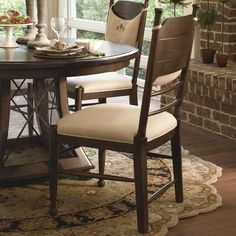 Compliment your kitchen table or formal dining room table with the thoughtful and timeless design of the Down Home Side Chair. The attractive piece features a country style panel and spindle back, with rounded finials and stretchers. An upholstered seat provides a nice contrast from the poplar wood. Adding an option of detail and decor is a removable hand-tied back pillow that displays the Paula Deen logo. A thoughtful design for a thoughtful chair, this chair is sure to bring out the best…