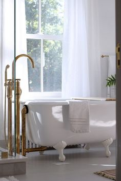 The room has tall windows and a Strom Plumbing Geneva Cast-Iron Clawfoot Tub with a Waterworks Henry Exposed Floor-Mounted Tub Filler in unlacquered brass. Photograph by Jersey Ice Cream Co. Bathroom Trends, Bathroom Designs, Bathroom Ideas, Bathroom Goals, Bath Ideas, Beautiful Houses Interior, Bathroom Floor Tiles, Waterworks Bathroom, Modern Farmhouse Kitchens