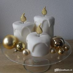 Oh my gosh, I want to make these right now....would be a good use for my 5 lbs. of leftover white fondant... candle cakes