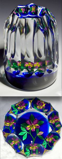 "Bob Banford paperweight - pansy with a single flower blossom, one bud and green leaves against a cobalt blue ground. There are fourteen side flutes and one top facet. 2 1/8""t x 2 7/8""w, 12.7 oz. - #0262"