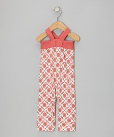 Thanks to its hip silhouette, cross-back straps and punchy print, this jumpsuit is a one-piece wonder with style to spare. Made from soft organic cotton, it's extra gentle on sensitive skin and features leg snaps for easy changing.