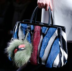 Love this mink bag and fox keychain by Fendi