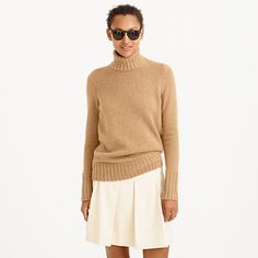 5. A cashmere or wool turtleneck | We love a good cashmere turtleneck, but this one—with exaggerated rib trim at the neck and wrists—has an extra-special place in our hearts (and our sweater drawer).