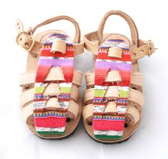 http://humblehilo.com/collections/baby-sandals/products/closed-toe-sandal-arco-iris-1