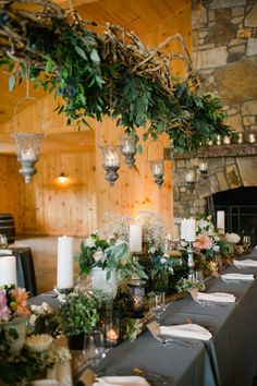hanging greenery, twigs + lanterns centerpiece #wedding #reception #eventdesign #entertaining // Oh! Darling Photography, floral design: The Bloom Room