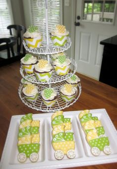 Yellow and green baby shower cookies and cupcakes