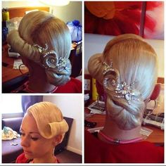 Low bun with large curled bang swoop. If your hair is light enough to hold this look, this is a great hairstyfle for latin and standard ballroom. Visit http://ballroomguide.com/comp/hair_make_up.html for more hair and makeup info